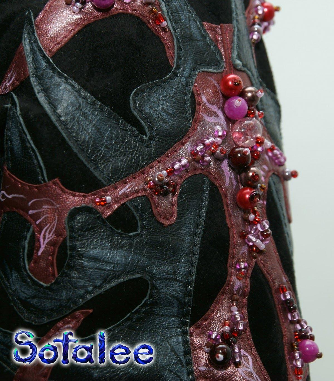 женственная дизайнерская кожаная куртка